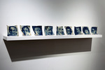 B'shert (What's meant to be will be), Cyanotypes on eggshells and matzo crackers, glass vases, acrylic book stands, LED lights 72 in x 12 in by chloe dichter